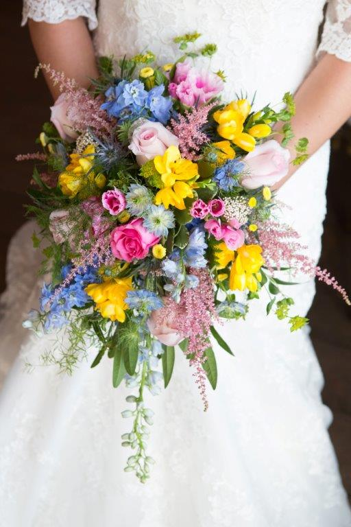 Roses, Delphiniums, Wax Flower, Astilbe, Freesia textured cascade bridal bouquet