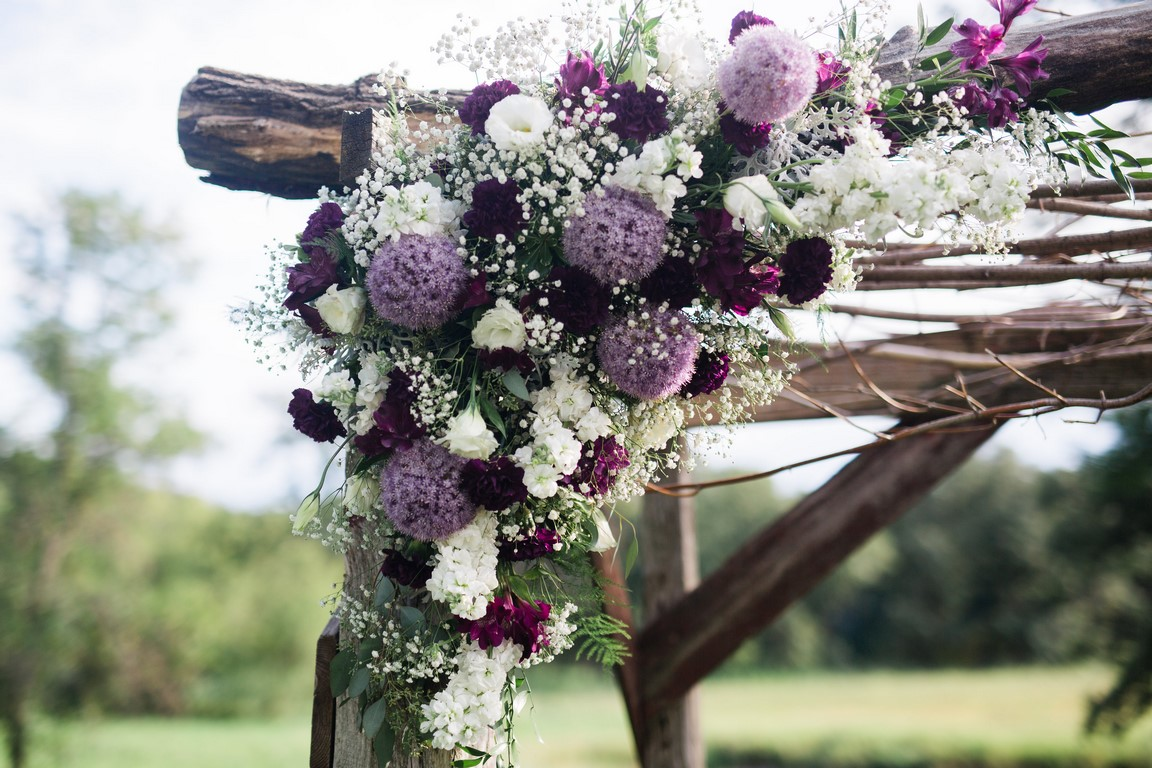 Wedding flowers in shades of plum, lavender and white. Alliums, Lisanthus, Stock, Carnations, Babies Breath