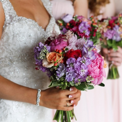 Springtime wedding bouquets of Stock, Peonies, Roses, Ranunculus, Hypericum Berries, Wax Flower, Freesia, Astilbe