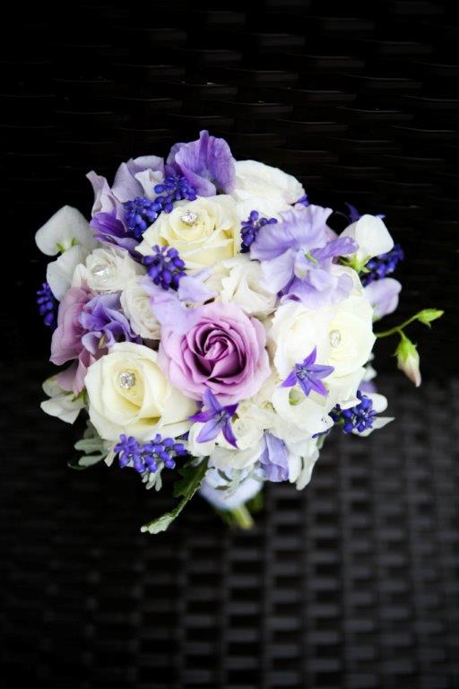 Soft romantic wedding bouquet of Roses, Lisanthus, Muscari