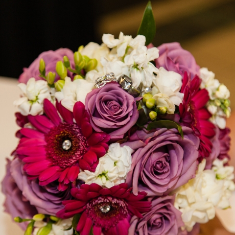 Shades of Fuschia, Lilac, White and Green Wedding Bouquet that includes Gerbera Daisy, Roses, Stock, Hypericum Berries