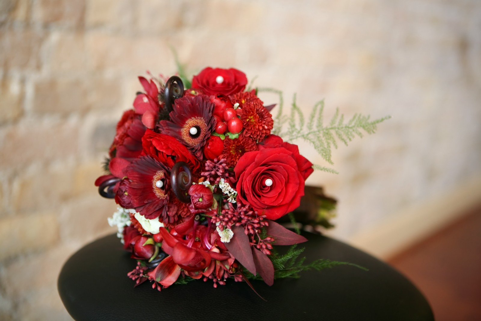 Shades fo Red and Ivory Flowers. Roses, Gerberas, Chrysanthemums, Seeded Eucalyptus, Plumosa, Hypericum Berries